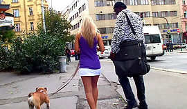 Black-skinned stranger is flirting with a boylike doglover