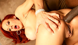 Red haired damsel is bendable over and this gigantic dark-skinned cock is banging her