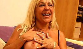 Cutie mature young woman is touching her bra buddies seductively and provocative